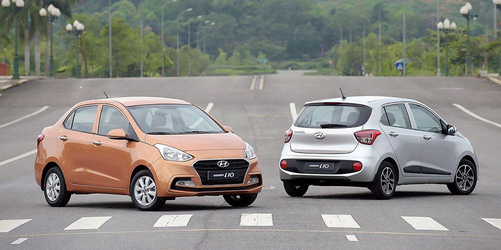 Hyundai Grand i10 Sedan (màu cam) và Hyundai Grand i10 Hatchback (màu trắng) - Hyundai Vĩnh Long